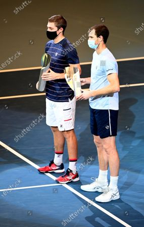Jamie Murray (R) and Neal Skupski (L) of Britain pose with their runner-up trophy after losing the doubles final match against Lukasz Kubot of Poland and Marcelo Melo of Brazil at the Erste Bank Open ATP tennis tournament in Vienna, Austria, 01 November 2020.