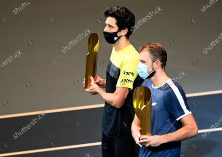 Lukasz Kubot of Poland (R) and Marcelo Melo of Brazil (L) pose with their trophy after winning their doubles final match against Jamie Murray and Neal Skupski of Britain at the Erste Bank Open ATP tennis tournament in Vienna, Austria, 01 November 2020.