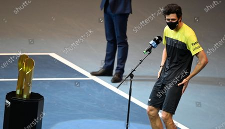 Marcelo Melo of Brazil delivers a speech in front of the  trophy after winning the doubles final match against Jamie Murray and Neal Skupski of Britain at the Erste Bank Open ATP tennis tournament in Vienna, Austria, 01 November 2020.