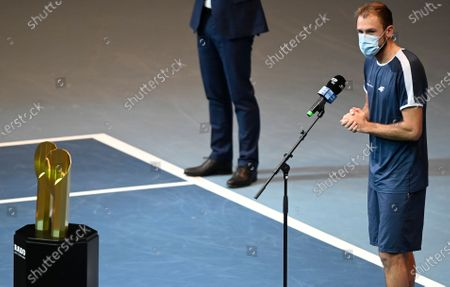 Lukasz Kubot of Poland delivers a speech in front of the  trophy after winning the doubles final match against Jamie Murray and Neal Skupski of Britain at the Erste Bank Open ATP tennis tournament in Vienna, Austria, 01 November 2020.