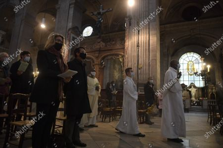 Former French prime minister and Councillor of Barcelona city, Manuel Valls (R), and his wife Susana Gallardo (L) attend a mass for the All Saints Catholic holiday at the Saint Sulpice Church and to pay their respects to the victims of the terror attack at the Notre Dame basilica of Nice, in Paris, France, 01 November 2020. Three people have died in what officials treat as a terror attack. The attack comes less than a month after the beheading of a French middle school teacher in Paris on 16 October.