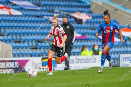 Jade Pennock of Sheffield United WFC and Siobhan Wilson of Crystal Palace W race for the ball during the FA Women's Championship match between Sheffield United Women and Crystal Palace Women at Sir Tom Finney Stadium, Preston