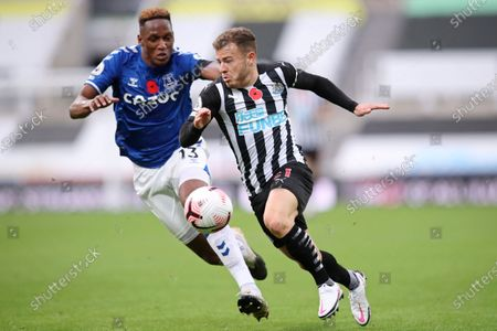 Stock Picture of Everton's Yerry Mina, left, challenges for the ball with Newcastle's Ryan Fraser during an English Premier League soccer match between Newcastle United and Everton at the St. James' Park stadium in Newcastle, England
