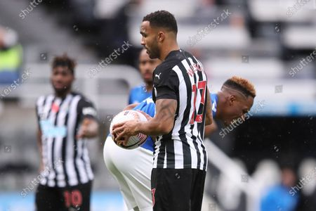 Stock Photo of Everton's Yerry Mina, right, doubles over after Newcastle's Callum Wilson shoved the ball into his stomach before taking a penalty kick during an English Premier League soccer match between Newcastle United and Everton at the St. James' Park stadium in Newcastle, England