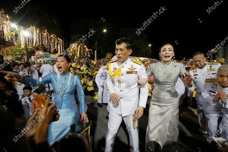 Thai King Maha Vajiralongkorn Bodindradebayavarangkun (C) is accompanied with Thai Queen Suthida (R) and Thai Princess Sirivannavari Nariratana (L) greet royalists after a royal ceremony at the Grand Palace in Bangkok, Thailand, 01 November 2020. Thousands of royalists gathered to show their support to the Thai King after the pro-democracy protesters held street protests calling for a monarchy reform.