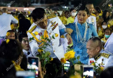 Thai King Maha Vajiralongkorn Bodindradebayavarangkun (L) staggers and is assisted by Thai Princess Sirivannavari Nariratana (R) royalists during a public appearance of royal family members outside the Grand Palace in Bangkok, Thailand, 01 November 2020. Thousands of royalists gathered to show their support to the Thai King after the pro-democracy protesters held street protests calling for a monarchy reform.