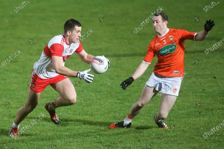 Derry vs Armagh. Derry's Padraig Cassidy and Armagh's Ryan Kennedy