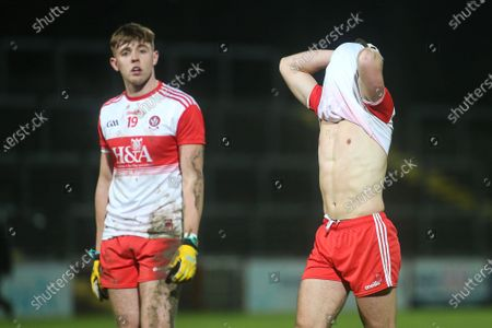 Stock Image of Derry vs Armagh. Derry's Oisin McWilliams and Shane McGuigan at the end of the game