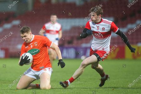 Derry vs Armagh. Armagh's Oisin O'Neill and Derry's Brendan Rogers