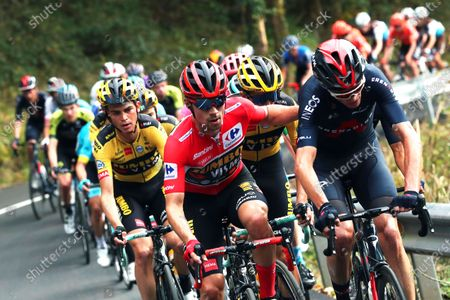 Slovenian rider Primoz Roglic (front L) of Team Jumbo-Visma wearing the overall leader's red jersey and British rider Christopher Froome (R) of the Ineos Grenadier team in action during the 12th stage of the Vuelta a Espana 2020 cycling race over 109.4km between Pola de Laviana and Alto de l'Angliru, near Grandiella, northern Spain, 01 November 2020.