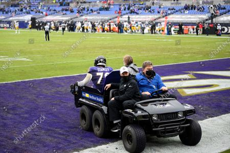 Baltimore Ravens offensive tackle Ronnie Stanley is carted off the field during the first half of an NFL football game against the Pittsburgh Steelers, in Baltimore
