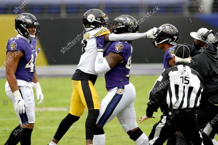 Baltimore Ravens outside linebacker Matt Judon, center, pushes Pittsburgh Steelers wide receiver Diontae Johnson, center left, away during an altercation with Ravens cornerback Marcus Peters, center right, during the first half of an NFL football game, in Baltimore