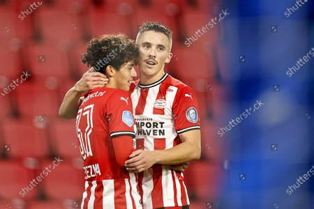 Richard Ledezma (L) and Ryan Thomas or PSV Eindhoven celebrate the 3-0 goal during the Dutch Eredivisie match between PSV Eindhoven and ADO Den Haag at the Phillips stadium in Eindhoven, The Netherlands, 01 November 2020.