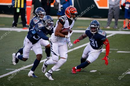 Cincinnati Bengals' Tyler Boyd (83) is tackled by Tennessee Titans' Chris Jackson (35) during the second half of an NFL football game, in Cincinnati