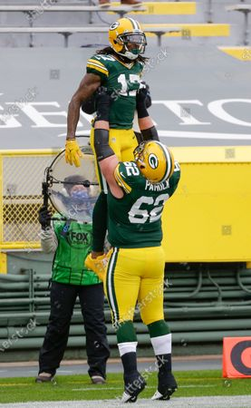 Green Bay Packers wide receiver Davante Adams (17) is listen by Green Bay Packers offensive guard Lucas Patrick (62) after a touchdown during an NFL football game, Sunday, Nov 1. 2020, between the Minnesota Vikings and Green Bay Packers in Green Bay, Wis