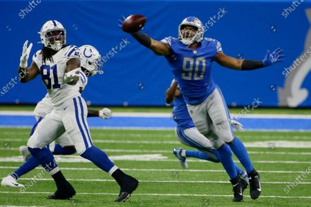 Stock Image of Detroit Lions defensive end Trey Flowers (90) deflects a pass intended for Indianapolis Colts tight end Mo Alie-Cox (81) during the first half of an NFL football game, in Detroit