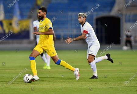 Al-Shabab's player Ever Banega (R) in action against Al-Nassr's Ali Al-Hassan (L) during the Saudi Professional League soccer match between Al-Shabab and Al-Nassr at Prince Faisal Bin Fahd Stadium in Riyadh, Saudi Arabia, 1 November 2020.