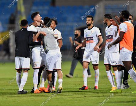 Al-Shabab's players celebrate after winning the Saudi Professional League soccer match between Al-Shabab and Al-Nassr at Prince Faisal Bin Fahd Stadium in Riyadh, Saudi Arabia, 1 November 2020.