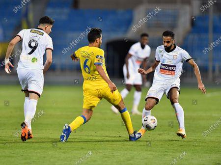 Al-Shabab's player Abdullah Alhamddan (L) in action against Al-Nassr's Petros (C) during the Saudi Professional League soccer match between Al-Shabab and Al-Nassr at Prince Faisal Bin Fahd Stadium in Riyadh, Saudi Arabia, 1 November 2020.