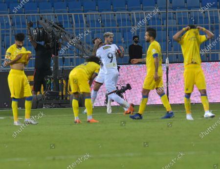 Al-Shabab's player Ever Banega (back) celebrates with teammate after scoring the winning goal during the Saudi Professional League soccer match between Al-Shabab and Al-Nassr at Prince Faisal Bin Fahd Stadium in Riyadh, Saudi Arabia, 1 November 2020.