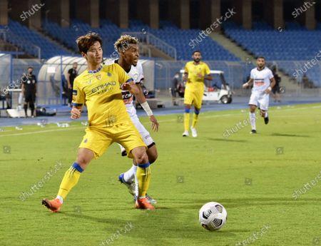 Al-Shabab's player Fawaz Al-Sagour (back) in action against Al-Nassr's Jin-su Kim (front) during the Saudi Professional League soccer match between Al-Shabab and Al-Nassr at Prince Faisal Bin Fahd Stadium in Riyadh, Saudi Arabia, 1 November 2020.