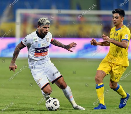 Al-Shabab's player Ever Banega (L) in action against Al-Nassr's Gonzalo Martinez (R) during the Saudi Professional League soccer match between Al-Shabab and Al-Nassr at Prince Faisal Bin Fahd Stadium in Riyadh, Saudi Arabia, 1 November 2020.