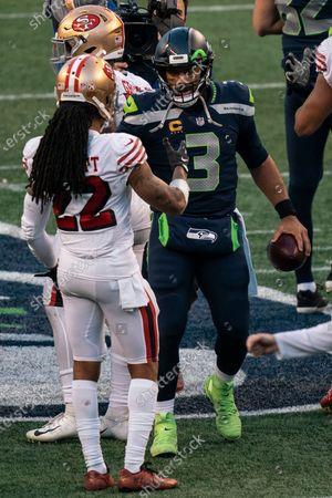 Seattle Seahawks quarterback Russell Wilson (3) and San Francisco 49ers cornerback Jason Verrett talk after an NFL football game, in Seattle. The Seahawks won 37-27