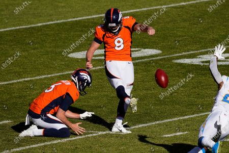 Denver Broncos kicker Brandon McManus (8) kicks a field goal as punter Sam Martin (6) holds during the first half of an NFL football game against the Los Angeles Chargers, in Denver