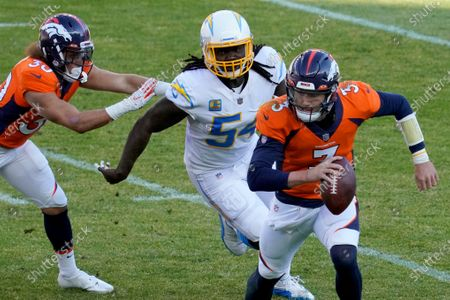Los Angeles Chargers defensive end Melvin Ingram (54) chases down Denver Broncos quarterback Drew Lock (3) during the first half of an NFL football game, in Denver
