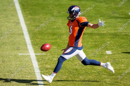 Denver Broncos punter Sam Martin (6) punts the football while warming up against the Los Angeles Chargers before an NFL football game, in Denver