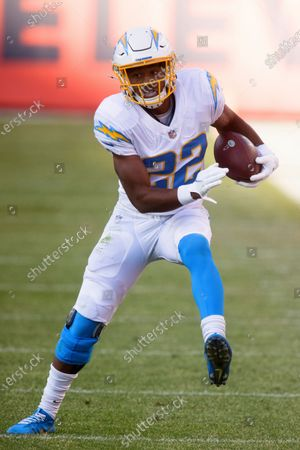 Los Angeles Chargers running back Justin Jackson (22) runs with the football against the Denver Broncos during the first half of an NFL football game, in Denver