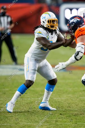 Los Angeles Chargers defensive end Melvin Ingram III (54) rushes against Denver Broncos offensive tackle Garett Bolles (72) during the second half of an NFL football game, in Denver. The Denver Broncos defeated the Los Angeles Chargers 31-30