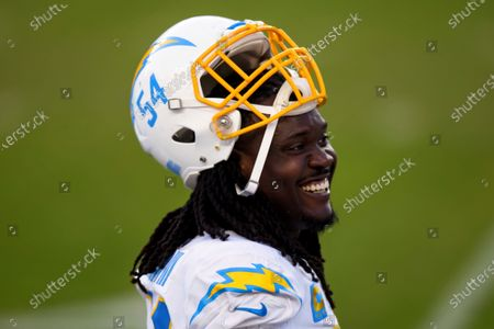 Los Angeles Chargers defensive end Melvin Ingram III (54) smiles on the sidelines against the Denver Broncos during the second half of an NFL football game, in Denver. The Denver Broncos defeated the Los Angeles Chargers 31-30