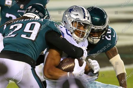 Stock Picture of Dallas Cowboys' Tony Pollard (20) is grabbed by the Philadelphia Eagles' Avonte Maddox (29) and Will Parks (28) during an NFL football game, in Philadelphia. The Eagles defeated the Cowboys 23-9