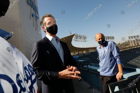 Stock Picture of Los Angeles, California-Oct. 30, 2020-Gov. Gavin Newsom, left, visits Dodger Stadium with Dodger president/CEO Stan Kasten, right, on Oct. 30, 2020.