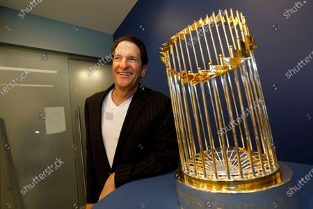 Los Angeles, California-Oct. 30, 2020-On Oct. 30, 2020, Dodger owner Peter Guber has his picture taken with the World Series trophy the Dodgers team just won.