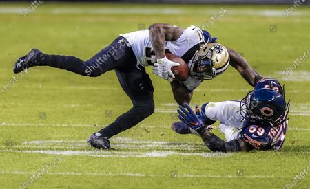 Chicago Bears inside linebacker Danny Trevathan (R) tackles New Orleans Saints wide receiver Deonte Harris (L) during the NFL game between the New Orleans Saints and the Chicago Bears at Soldier Field in Chicago, Illinois, USA, 01 November 2020.