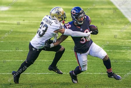 Chicago Bears running back David Montgomery (R) runs on New Orleans Saints cornerback Marshon Lattimore (L) during the NFL game between the New Orleans Saints and the Chicago Bears at Soldier Field in Chicago, Illinois, USA, 01 November 2020.