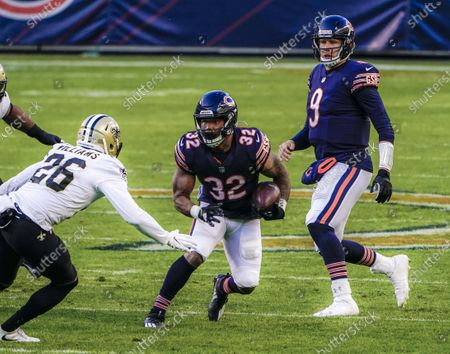 Chicago Bears quarterback Nick Foles (R) watches as Chicago Bears running back David Montgomery (C) runs the ball on New Orleans Saints cornerback P.J. Williams (L) during the NFL game between the New Orleans Saints and the Chicago Bears at Soldier Field in Chicago, Illinois, USA, 01 November 2020.