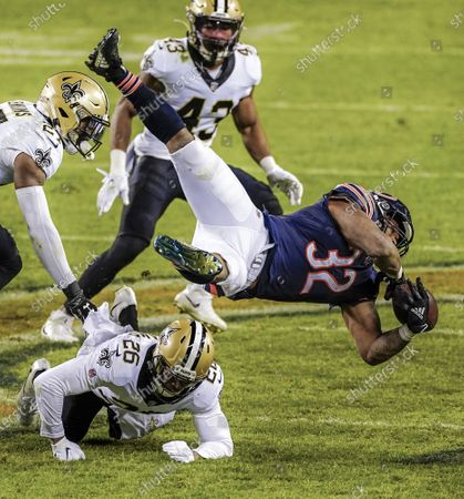 Chicago Bears running back David Montgomery (R) loses the ball as he is upended by New Orleans Saints cornerback P.J. Williams (L) during the NFL American Football game between the New Orleans Saints and the Chicago Bears at Soldier Field in Chicago, Illinois, USA, 01 November 2020.