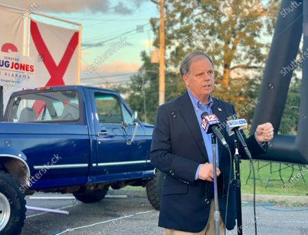 Democratic U.S. Sen. Doug Jones, of Alabama, speaks at a drive-in car rally in Troy, Ala., on . Jones faces Republican Tommy Tuberville in Tuesday's election