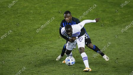Orlando City midfielder Benji Michel, right, and Montreal Impact defender Zachary Brault-Guillard battle for the ball during their MLS match, at Red BullArena in Harrison, NJ
