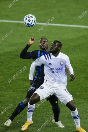 Stock Photo of Orlando City midfielder Benji Michel, right, and Montreal Impact defender Zachary Brault-Guillard battle for the ball during their MLS match, at Red BullArena in Harrison, NJ