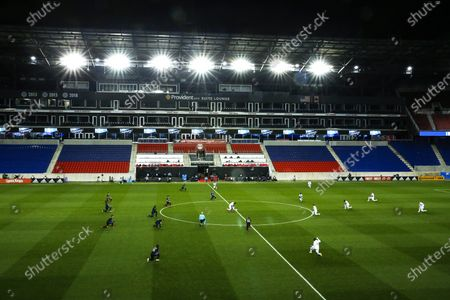 Orlando City and Montreal Impact players take a knee before their MLS match, at Red BullArena in Harrison, NJ