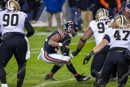 Chicago, Illinois, U.S. - Bears #32 David Montgomery runs with the ball during the NFL Game between the New Orleans Saints and Chicago Bears at Soldier Field in Chicago, IL. Photographer: Mike Wulf