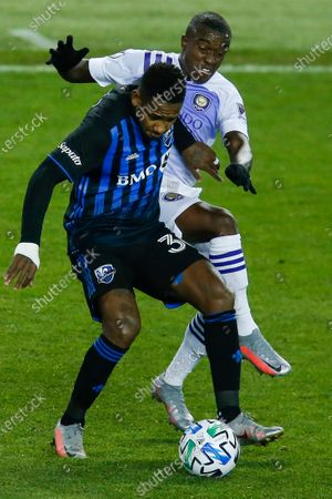 Orlando City midfielder Sebastian Mendez, right, and Montreal Impact attacker Romell Quioto battle for the ball during their MLS match, at Red BullArena in Harrison, NJ