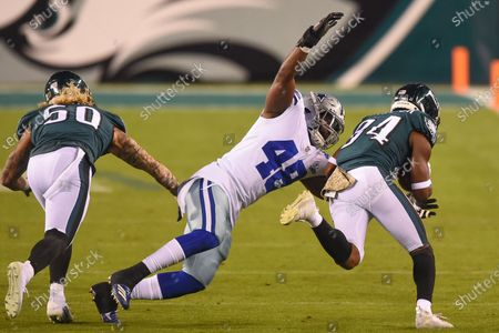 Dallas Cowboys linebacker Joe Thomas (48) tries to tackle Philadelphia Eagles wide receiver Greg Ward (84) during the NFC matchup between the Dallas Cowboys and the Philadelphia Eagles at Lincoln Financial Field in Philadelphia, PA