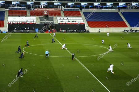 Orlando City and Montreal Impact players take a knee before their MLS soccer match, at Red BullArena in Harrison, NJ