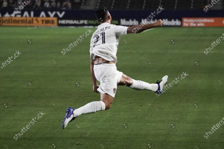 Stock Photo of Los Angeles Galaxy's Giancarlo Gonzalez celebrates his goal against Real Salt Lake during the first half of an MLS soccer match, in Carson, Calif