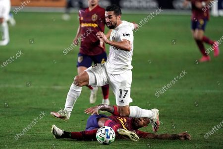 Los Angeles Galaxy's Sebastian Lletget, top, avoids a tackle from Real Salt Lake's Everton Luiz during the first half of an MLS soccer match, in Carson, Calif